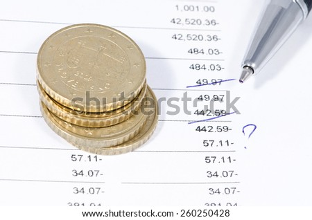 Reconciliation of financial data, handle circled controversial moments shallow depth of field - stock photo