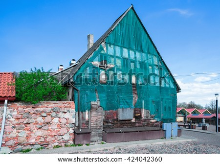 Reconstruction of Old wooden house near Market Square in Ventspils. It is a city in the Courland region of Latvia. Latvia is one of the Baltic countries - stock photo