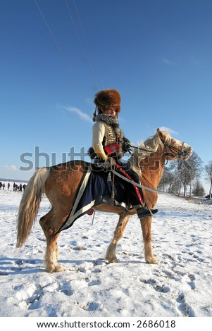 """Reconstruction of the 8 February 1807 Napoleon Battle of Preusisch-Eylau (East Prussia),  (Russia, Kaliningrad, village """"Bagrationovsk"""" now). February, 11th, 2007 - stock photo"""