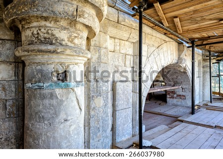 Reconstruction of the old stone church - stock photo