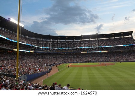 record crowd at Turner Field; night game, with amazing sky
