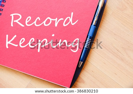Record keeping text concept write on notebook with pen - stock photo