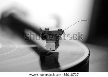 Record on turntable, close-up, black and white