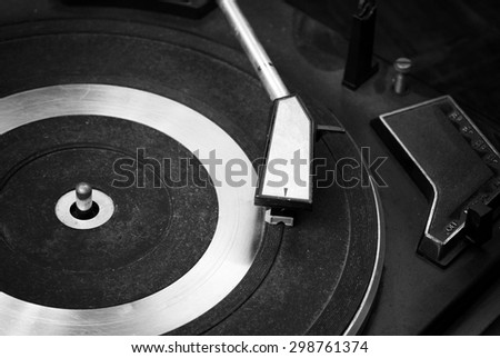 Record player stylus on a rotating disc, Picture of a vinyl record playing. ( Black and White ) - stock photo