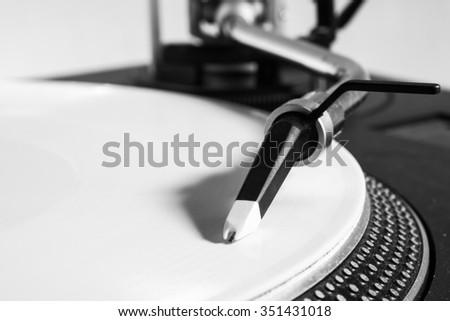 Record player with whtie vinyl - stock photo