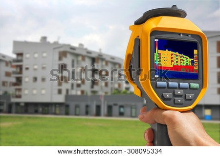 Recording Heat Loss at the Residential Building With Infrared Thermal Camera - stock photo