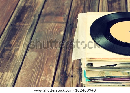 records stack and old record. vintage filtered - stock photo