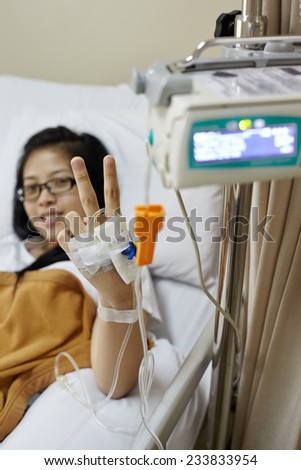 Recover patient smiling and pose to camera. Focus on the hand - stock photo