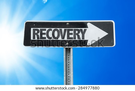 Recovery direction sign with a beautiful day - stock photo