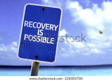 Recovery is Possible sign with a beach on background - stock photo