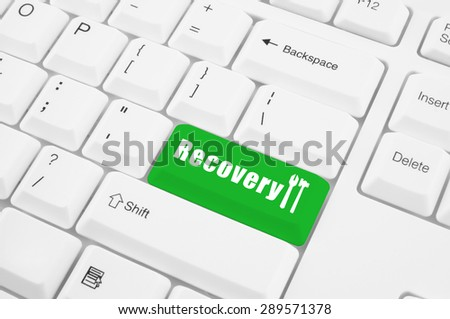 Recovery service concept, button recovery on computer keyboard - stock photo