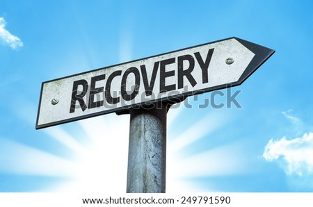 Recovery sign with a beautiful day - stock photo
