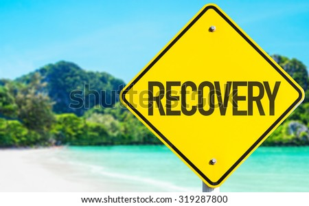 Recovery sign with beach background - stock photo