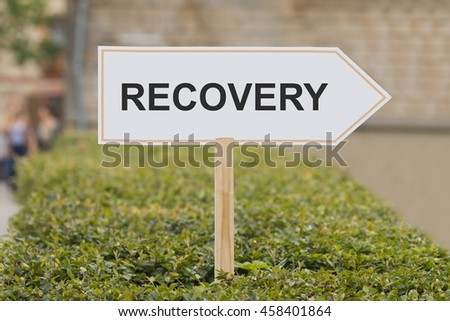 recovery signpost - stock photo