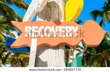 Recovery signpost with palm trees - stock photo