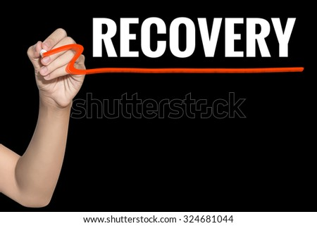 Recovery word write on black background by woman hand holding highlighter pen - stock photo