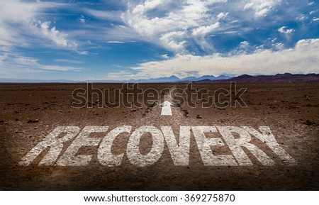 Recovery written on desert road - stock photo