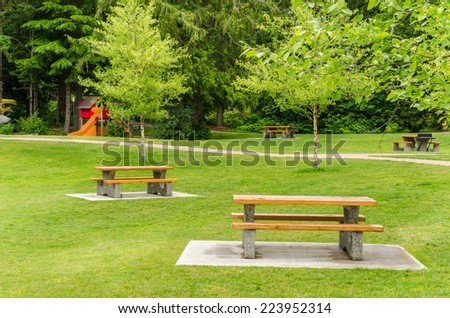 Recreation area with picnic tables - stock photo
