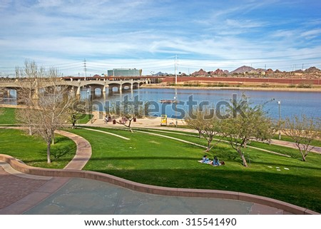 Recreation, Relaxation and outdoor activities along the shore of the Tempe Town Lake in Arizona - stock photo