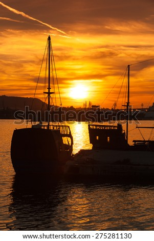 Recreation sailing ships stand moored in Varna port at the sunset. Bulgaria, vertical photo - stock photo