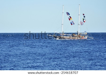 Recreational boat with flags of European countries in the Red sea. November 29, 2014. Sharm al Sheikh