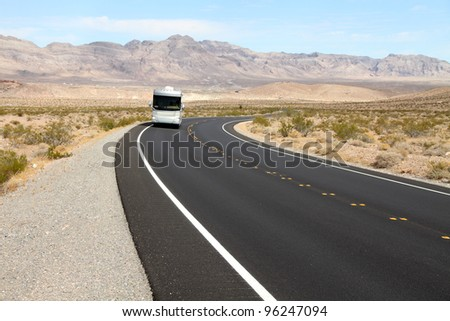 Recreational vehicle (RV) on scenic road - stock photo