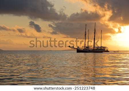 Recreational Yacht at the Indian Ocean. Beautiful sunrise - stock photo