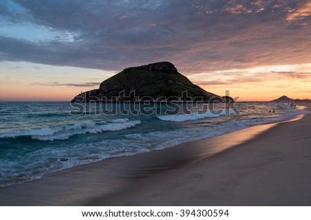 Recreio Beach by Sunset with Pontal Rock in the Ocean, Rio de Janeiro, Brazil - stock photo