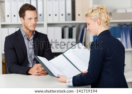 Recruiter and male candidate during a job interview - stock photo