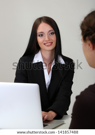 Recruiter checking candidate during job interview - stock photo