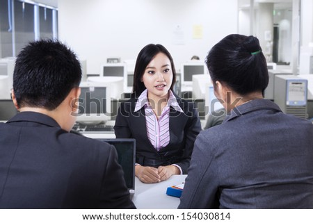 Recruiter checking the candidate during job interview at office - stock photo