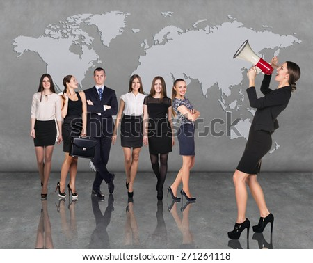 Recruitment agency. Business woman with megaphone standing in front of other busines people - stock photo