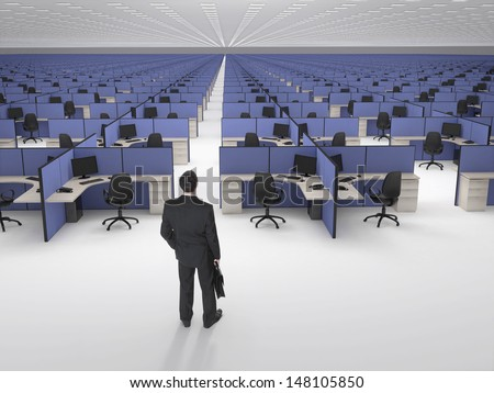 Recruitment.  Businessman in front of endless office cubicles. - stock photo