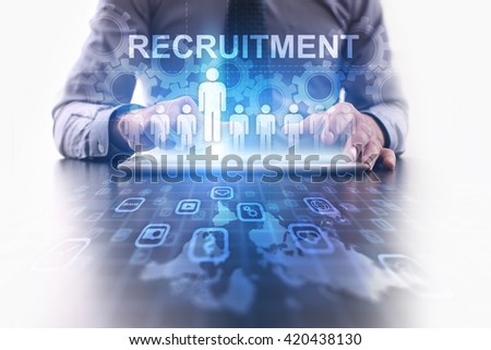 Recruitment concept. Businessman using futuristic tablet computer, pressing button on the touch screen and selecting Recruitment.  - stock photo