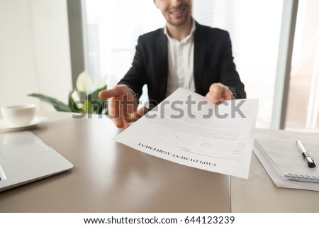 Recruitment manager reaching out sheet employment stock photo recruitment manager reaching out sheet with employment agreement smiling ceo offers to read and check platinumwayz