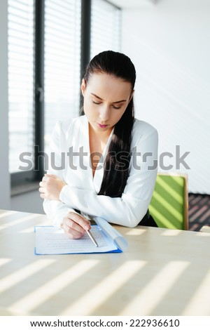Recruitment specialist preparing for the job interview and waiting for the candidate - stock photo