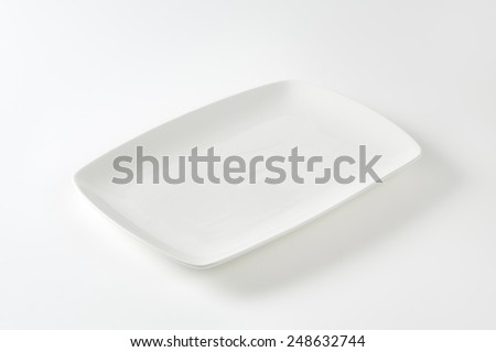 Rectangle all-white porcelain plate with rounded corners - stock photo