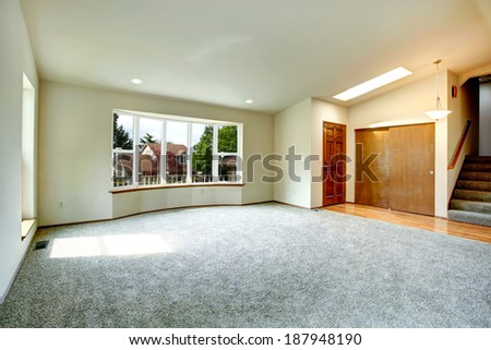 Rectangular bathroom with window. View of cabinets with black counter top and white bathroom with black tile trim - stock photo