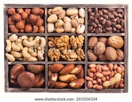 Rectangular box of variety nuts top view isolated on white - stock photo