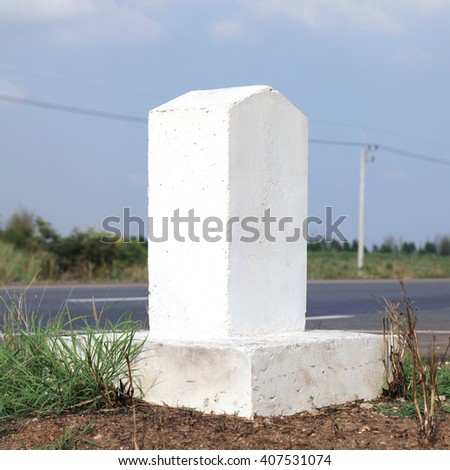 Rectangular columns made of cement embroidery on each side of a one kilometer distance on the road in the country
