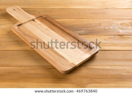 Rectangular Wooden Board on wooden background.