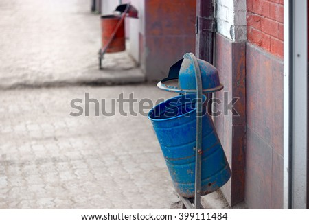 Recycle and Waste Receptacles of Blue and Red color in the street. - stock photo