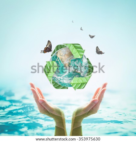 Recycle arrow sign leaf around green globe over beautiful woman human hands on blur abstract aqua blue water background: Recycle, reduce, reuse idea concept: Elements of this image furnished by NASA - stock photo
