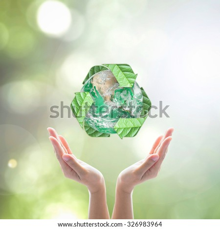 Recycle arrow sign leaf around green globe over beautiful woman human hands on blurred abstract bokeh background: Recycle, reduce, reuse idea concept: Elements of this image furnished by NASA