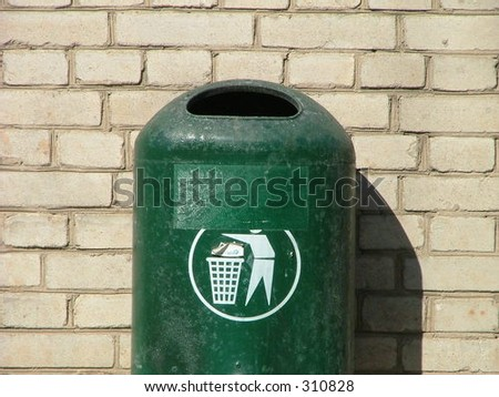 recycle bin attached to the wall