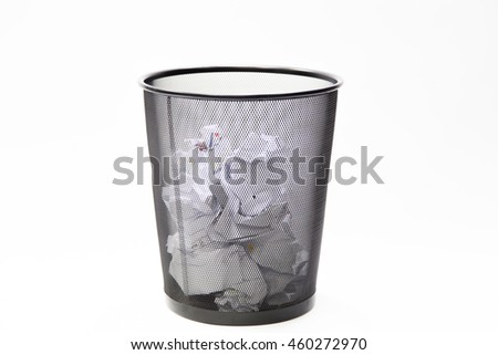 Recycle bin filled with crumpled papers. white background, - stock photo
