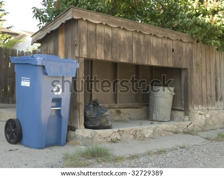 Recycle Bin next to Trash Can - stock photo