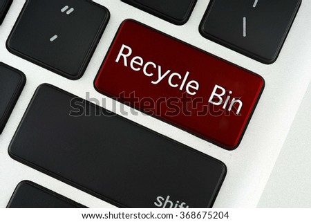 Recycle Bin text on red keyboard button - financial, business, online and data concept - stock photo