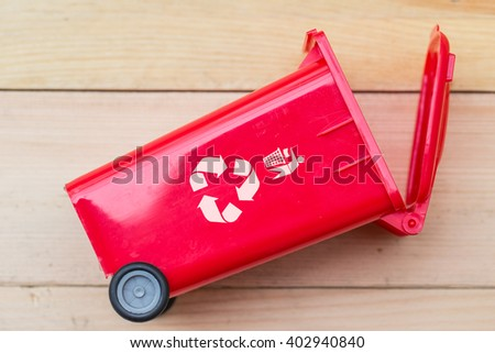 recycle bin trash bin with recycle logo on wood background. - stock photo
