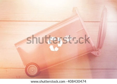 recycle bin trash bin with recycle logo on wood background classic light leak vintage color tone beautiful old style for postcard or background. - stock photo